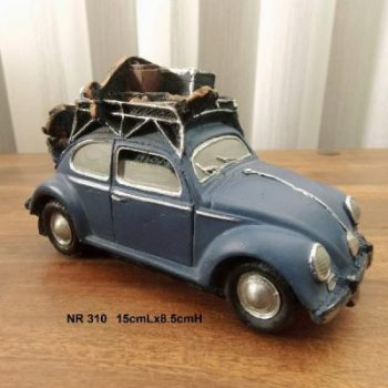 Auto met skies blauw 15cmLx8.5cmH